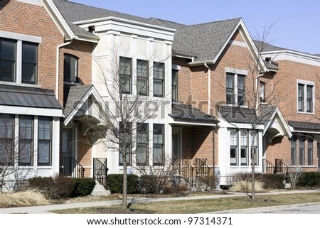 Townhouse on sunny winter day - stock photo