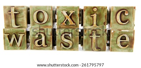 Toxic Waste spelled out with blocks on white background - stock photo