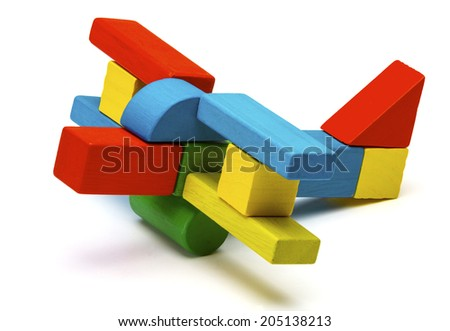toy airplane, multicolor wooden blocks air plane transport isolated white background - stock photo
