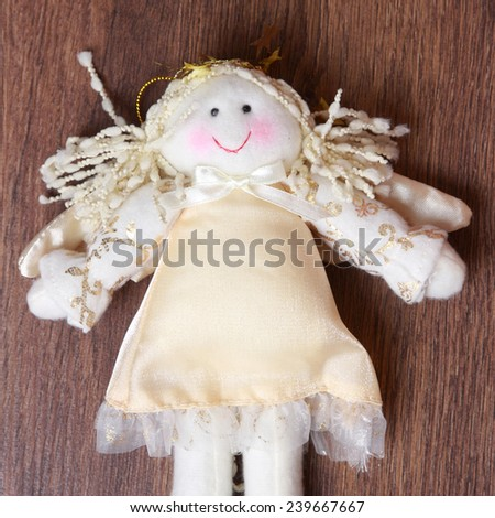 toy angel over wooden background on Holiday theme/Christmas toy Angel over wooden background - stock photo