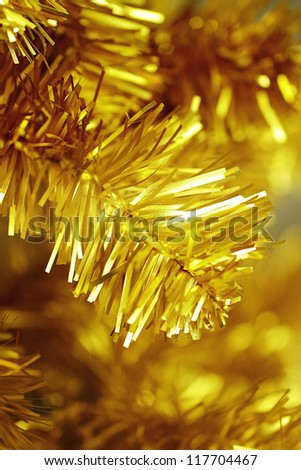 toy bells hanging on green spruce branch decorated - stock photo