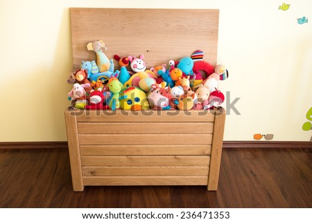 Toy Box full of soft toys in a child's bedroom - stock photo