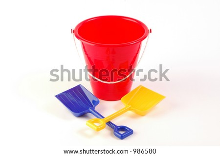Toy bucket on white background with two shovels - stock photo