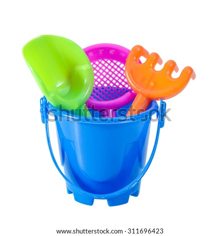 Toy bucket rake and spade isolated on white background - stock photo