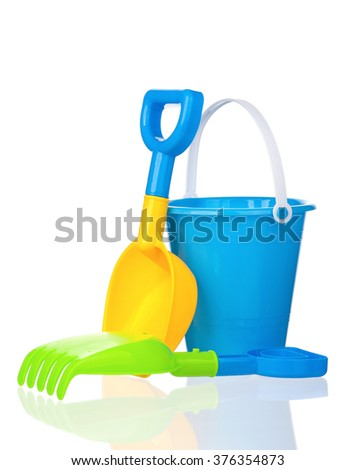 Toy bucket, rake and spade isolated on white background - stock photo