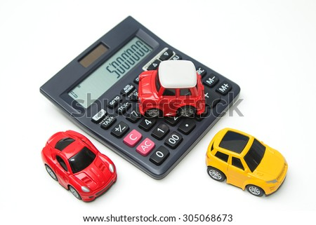 Toy car and calculator. Concept for finance and  insurance - stock photo