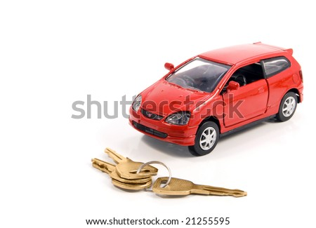 Toy car and keys over white. Rent or buy car concept - stock photo