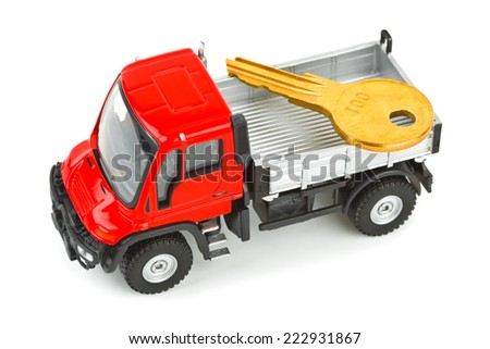 Toy car truck with key isolated on white background - stock photo