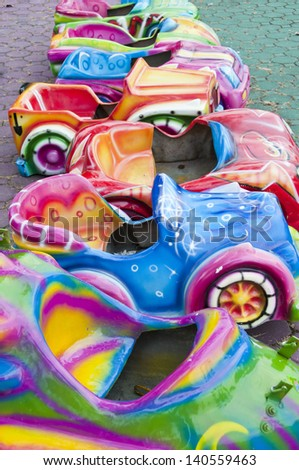 Toy cars in amusement park. - stock photo