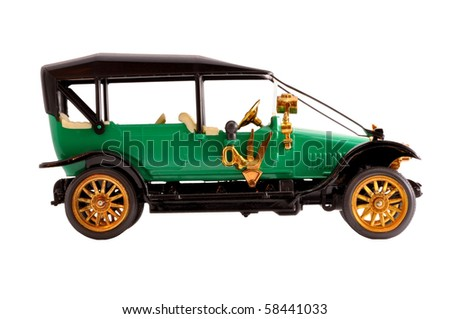 Toy collection scale model ancient green convertible car - stock photo