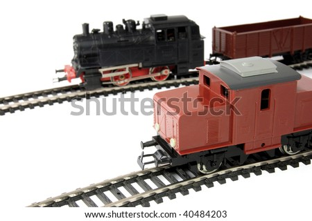 Toy Diesel Locomotive and Steam Train with freight wagon - stock photo