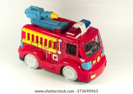 Toy fire truck on a white background - stock photo