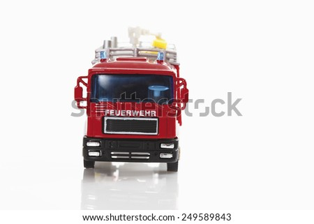 Toy fire truck on white background - stock photo