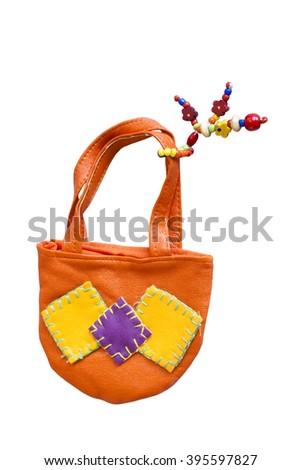 Toy handbag isolated over white background - stock photo