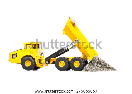 toy heavy truck is isolated over white background - stock photo
