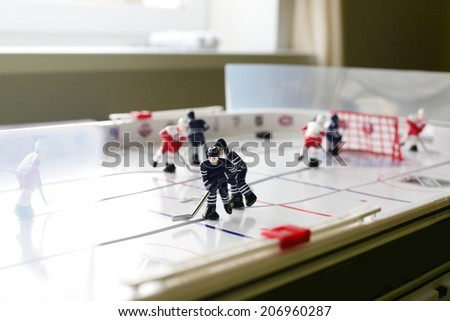 toy hockey table in the bright room - stock photo