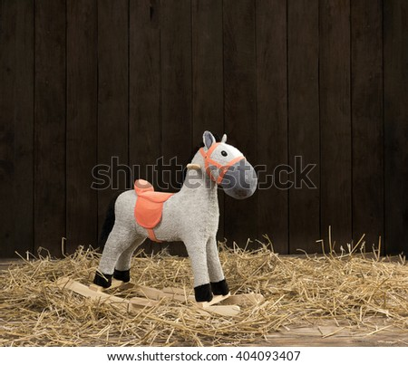 toy horse in a barn - stock photo
