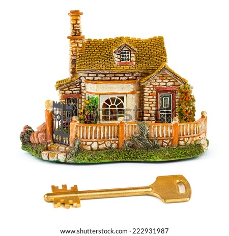 Toy house and key isolated on white background - stock photo