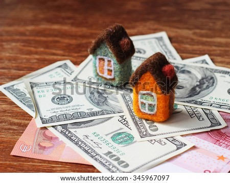toy houses and money - stock photo