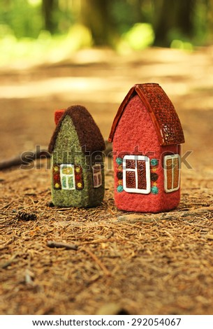 toy houses in forest - stock photo