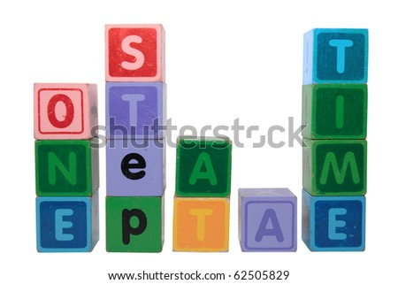 toy letters that spell one step at a time against a white background with clipping path - stock photo