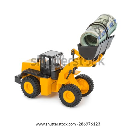 Toy loader and money isolated on white background - stock photo