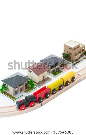 Toy locomotive runs the residential area - stock photo
