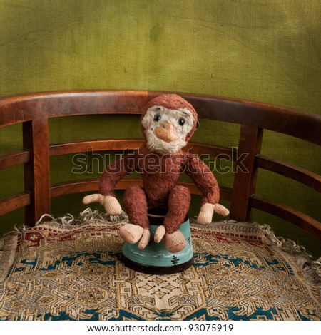 toy monkey in the arena square - stock photo
