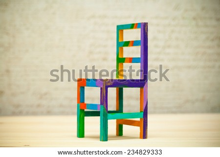 Toy multicolored wooden chair, modern art handmade - stock photo
