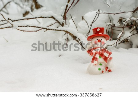 Toy of the snowman in snow - stock photo