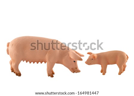 Toy pig and piglet isolated on white/Toy pig and piglet/Toy pig and piglet - stock photo