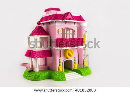 Toy pink two-storey cottage with a balcony. model is a beautiful home. - stock photo