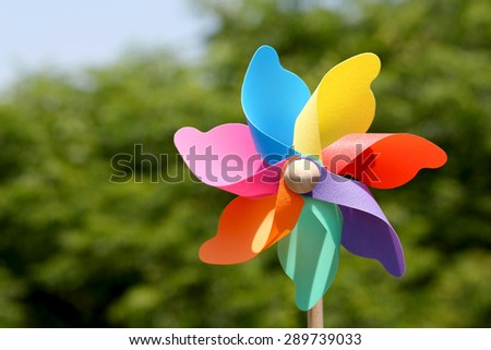 toy pinwheel in windy weather - stock photo
