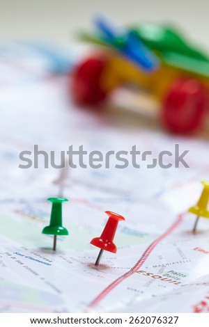 toy plane near map - stock photo