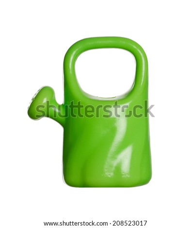 Toy plastic watering can isolated on white  - stock photo