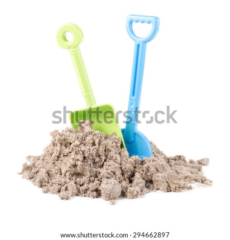 Toy rake and spade isolated on white background - stock photo