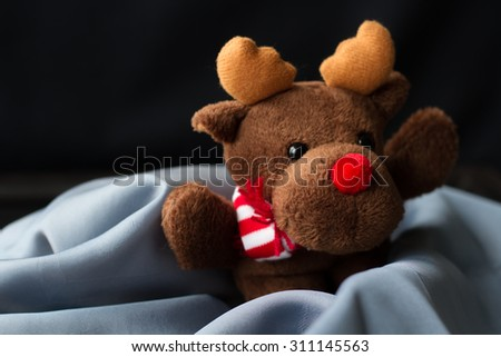 toy reindeer Christmas present child - stock photo