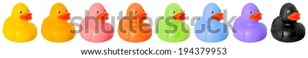 Toy rubber colored ducks isolated on white - stock photo