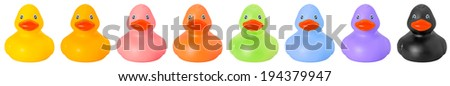 Toy rubber colored ducks isolated on white front side - stock photo