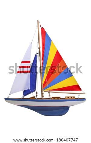 toy sailboat on white  - stock photo