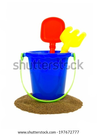 Toy sand pail with shovel and rake over a white background - stock photo