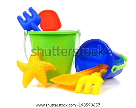 Toy sand pails and shovels over a white background - stock photo