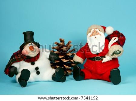 Toy Santa Claus and Snowman Christmas arrangement - stock photo