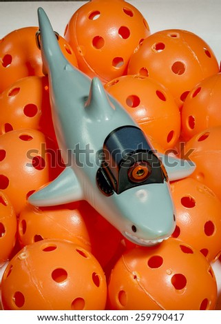 Toy shark with a laser on it - stock photo