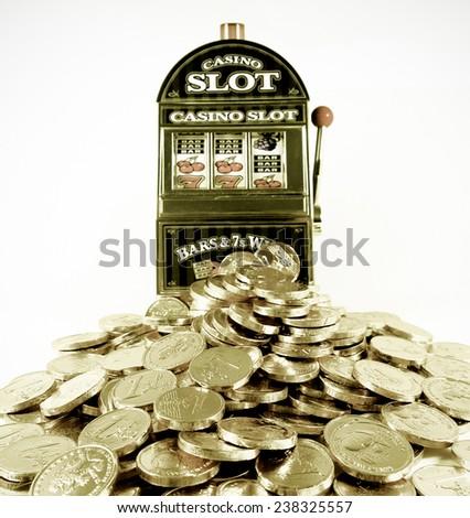 toy slot Machine and toy money  - stock photo