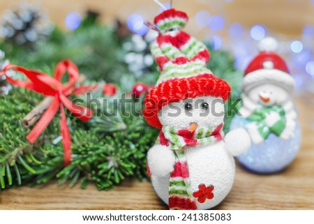 toy snowman Christmas wreath on a wooden background bokeh - stock photo