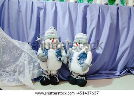 Toy snowmen as a detail in restautant decoration - stock photo