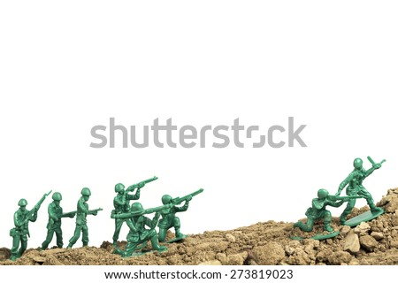 Toy soldiers march along the horizon in war image - stock photo