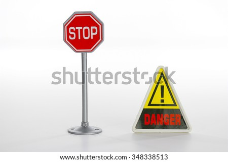 Toy stop road sign on white - stock photo