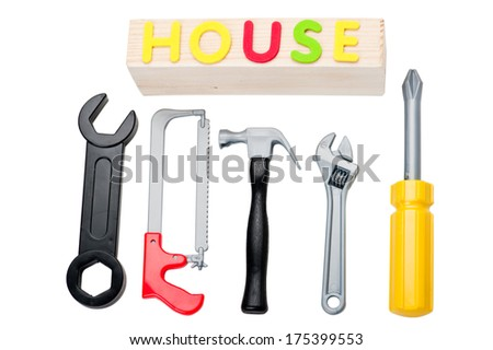 Toy tools and house sign - stock photo